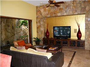 The family room has a wide screen and a waterfall