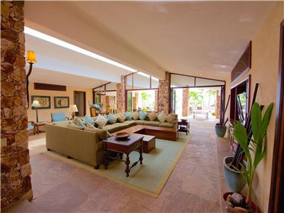 The living room opens to the pool area