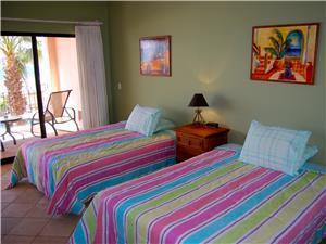 The guest bedroom has 2 queen size beds
