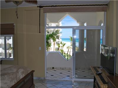 The master bedroom has an ocean view and patio