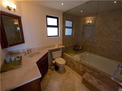 The master bathroom has a bathtub/shower.