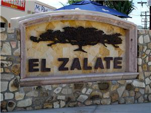 The street front sign at the El Zalate entrance