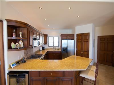 Kitchen with beautiful granite counter tops.