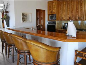 Full kitchen with counter bar