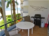 Balcony with dining set and BBQ