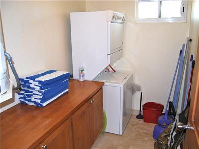 The condo has a private laundry room.