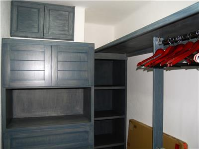The master bedroom walk in closet