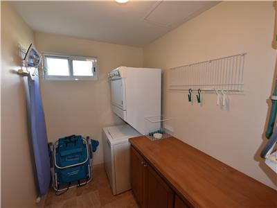 The condo has a laundry room with washer and dryer