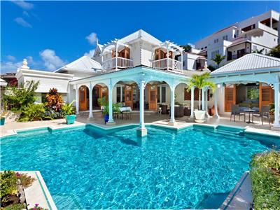 Caribbean villa with private pool amidst tropical garden