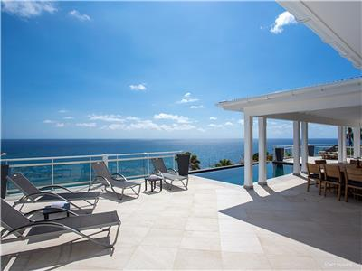 Beautiful and modern 4 bedroom home with a breathtaking view over the ocean as well as the islands o